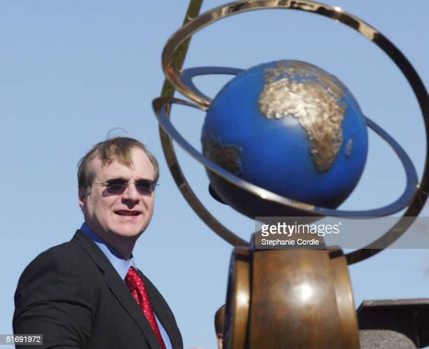 Paul Allen chairman of Charter Communication and cofounder of Microsoft looks towards the Ansari X Prize trophy during a ceremony in St Louis...