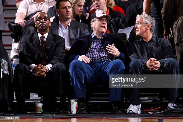 Paul Allen owner of the Portland Trail Blazers center sits with team president Larry Miller left and Pete Carroll head coach of the National Football...