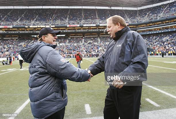 Paul Allen owner of the Seattle Seahawks greets Mike Holmgren head coach of the Seattle Seahawks before the NFC Divisional Playoff game at Qwest...