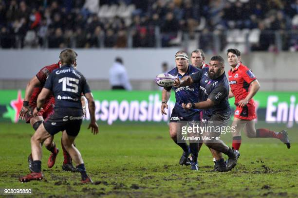 Paul Alo Emile of Stade Francais passes the ball during the European Rugby Challenge Cup match between Stade Francais and Edinburgh at Stade...