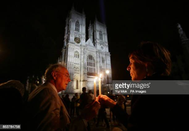 Paul and Alison Schulte holding candles outside Westminster Abbey in London during a candle lit prayer vigil and solemn reflection to mark centenary...
