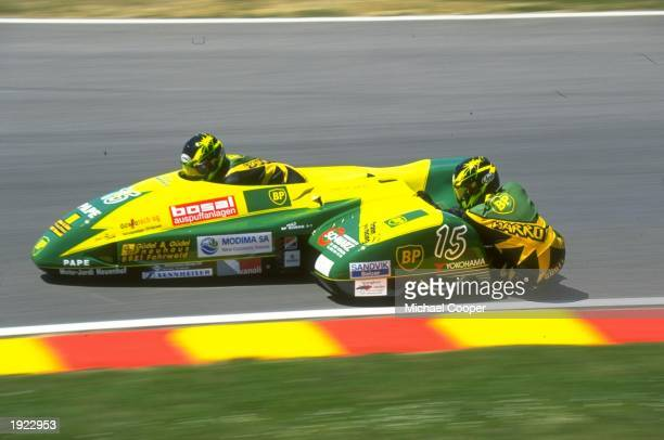 Paul and Charly Guedel of Switzerland in action during a sidecar race of the Italian Grand Prix at the Mugello circuit in Italy. The Guedels finished...