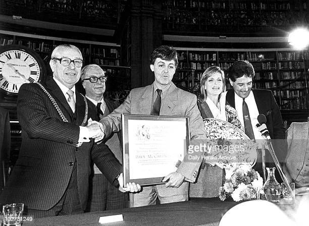 Paul and Linda McCartney Picton Library Liverpool November 1984 McCartney is granted the Freedom of the City of Liverpool Shaking his hand is...