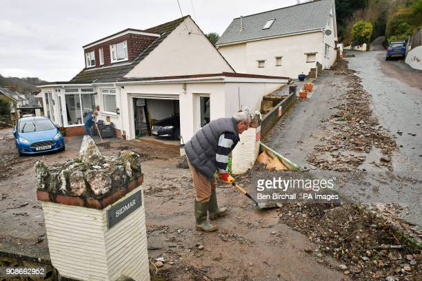 Paul and Lucy Davis clear silt and debris from their home on Corner Lane Combe Martin North Devon after flooding affected parts of the South West