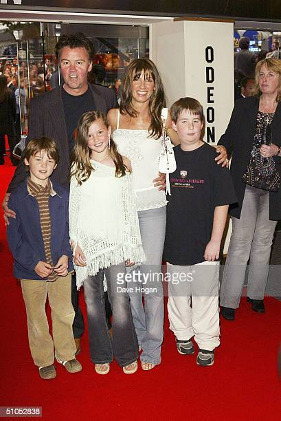 Paul and Stacey Young with family arrive at the UK film premiere of 'SpiderMan 2' at the Odeon Leicester Square on July 12 2004 in London