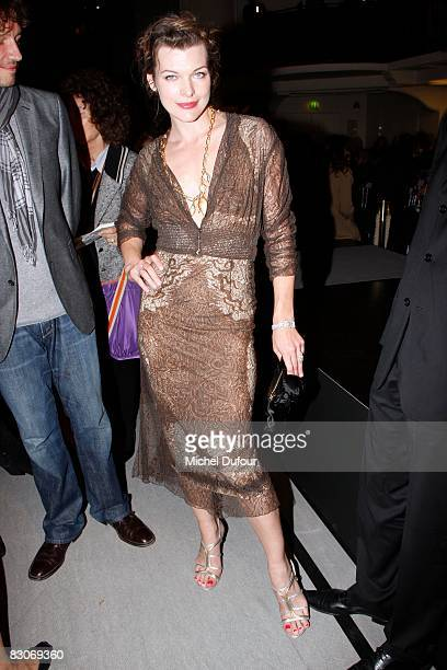 Paul Anderson and Milla Jovovitch attends the Jean Paul Gaultier Show during Paris Fashion Week on September 30 2008 in Paris France