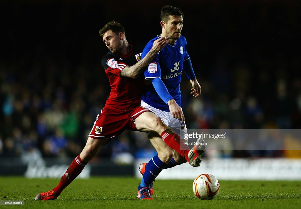Paul Anderson of Bristol City battles for the ball with David Nugent of Leicester City during the npower Championship match between Bristol City and Leicester City at Ashton Gate on January 12, 2013 in Bristol, England.