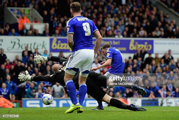 Paul Anderson of Ipswich scores past John Ruddy of Norwich during the Sky Bet Championship Playoff semifinal first leg match between Ipswich Town and...