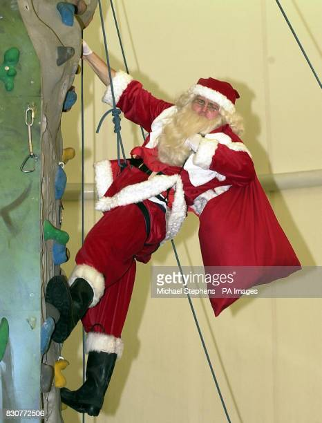 Paul Andrew who is a santa for the Tower Hamlets Housing Association in East London takes part in the fastest chimney climbing contest during the...