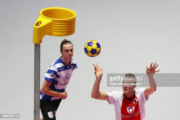 Paul Anholts of Top/Quoration gets past the tackle from Frank Mostard of BlauwWit during the Dutch Korfball League Final between BlauwWit and...