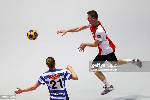 Paul Anholts of Top/Quoration passes the ball in front of Frank Mostard of BlauwWit during the Dutch Korfball League Final between BlauwWit and...