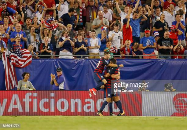 Paul Arriola Jordan Morris and Eric Lichaj of the United States celebrate a goal against Martinique during the second half of the CONCACAF Group B...
