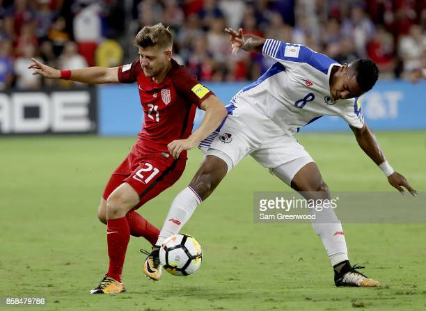 Paul Arriola of the United States drives past Edgar Barcenas of Panama during the final round qualifying match for the 2018 FIFA World Cup at Orlando...