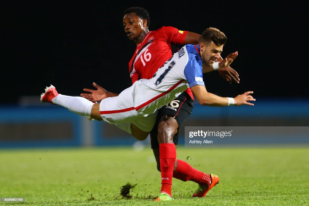 Paul Arriola (L) of the United States mens national team is tackled by Levi Garcia (R) of Trinidad and Tobago during the FIFA World Cup Qualifier match between Trinidad and Tobago at the Ato Boldon Stadium on October 10, 2017 in Couva, Trinidad And Tobago.