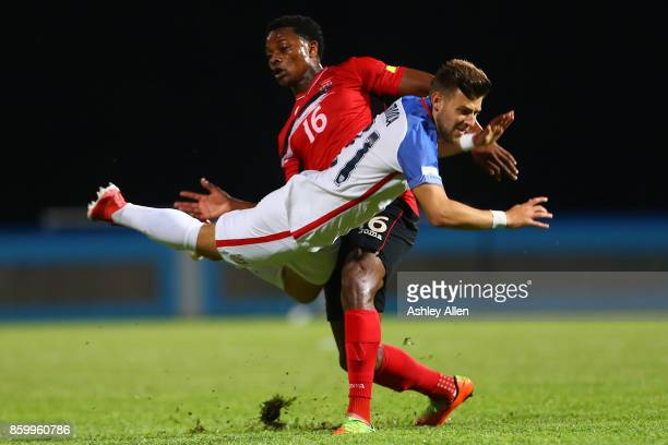 Paul Arriola of the United States mens national team is tackled by Levi Garcia of Trinidad and Tobago during the FIFA World Cup Qualifier match...