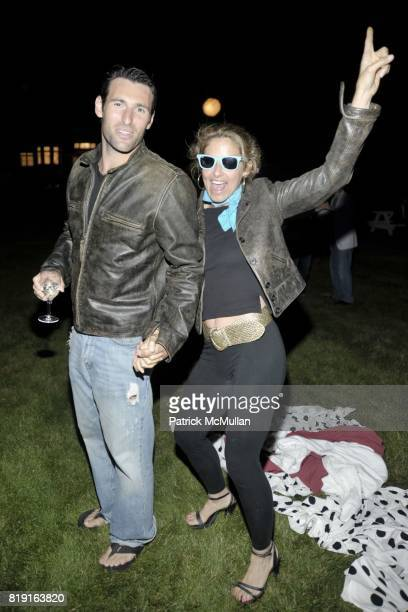 Paul Arrouet and Dylan Lauren attend THE CINEMA SOCIETY DIOR BEAUTY host the after party for GREASE SingALong at Katie Lee's Beach House on July 2...