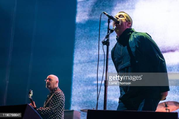 Paul Arthurs AKA Bonehead and Liam Gallagher perform at The O2 Arena on November 28, 2019 in London, England.