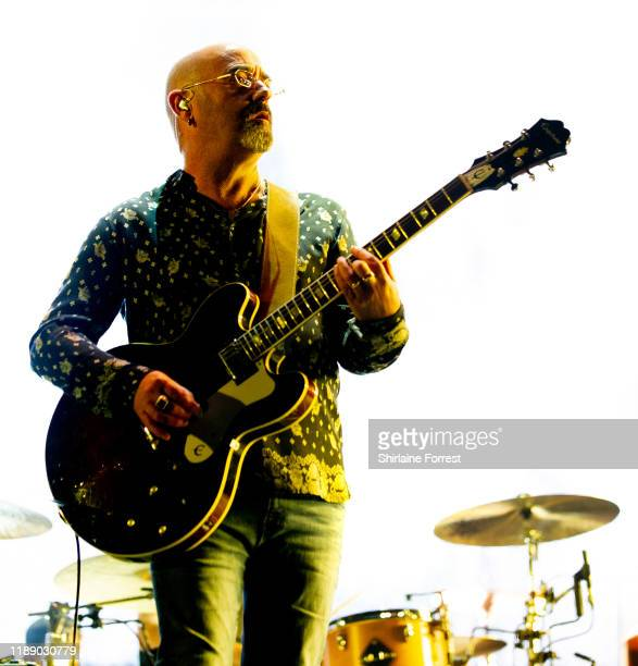 Paul Arthurs aka Bonehead performs with Liam Gallagher at Manchester Arena on November 20, 2019 in Manchester, England.