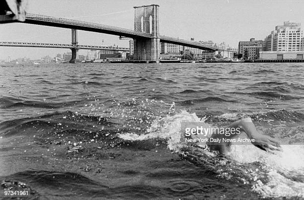 Paul Asmuthof the Manhattan Island Swimming Association swimming through the East River towards the Brooklyn Bridge during his record breaking swim...