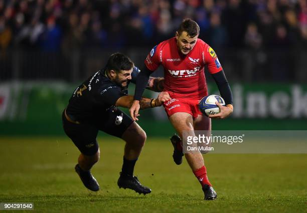 Paul Asquith of Scarlets is tackled by Matt Banahan of Bath during the European Rugby Champions Cup match between Bath Rugby and Scarlets at the...