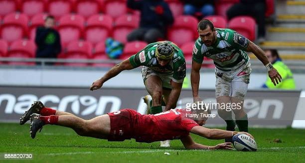 Paul Asquith of Scarlets scores his sides fifth and winning try during the European Rugby Champions Cup match between Scarlets and Benetton Rugby at...