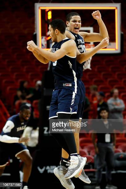 Paul Atkinson and Alex Copeland of the Yale Bulldogs celebrate after defeating the Miami Hurricanes in the HoopHall Miami Invitational at American...