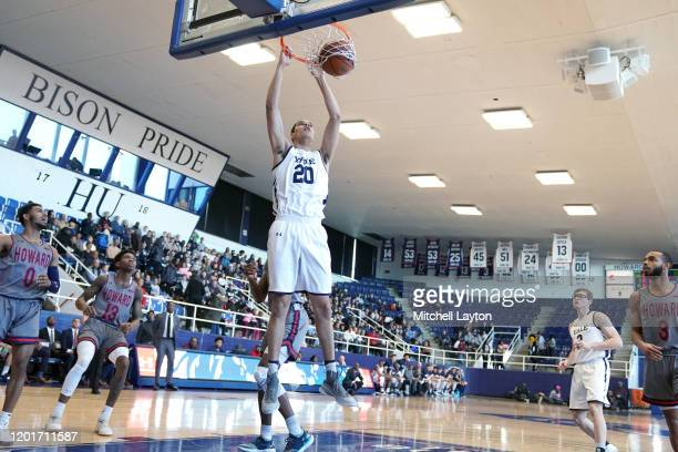 Paul Atkinson of the Yale Bulldogs dunks the ball during a college basketball game against the against the Howard Bison at Burr Gymnasium on January...