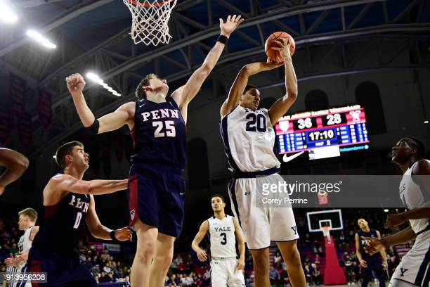Paul Atkinson of the Yale Bulldogs grabs the rebound from AJ Brodeur of the Pennsylvania Quakers during the second half at The Palestra on February 3...