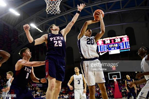 Paul Atkinson of the Yale Bulldogs out rebounds AJ Brodeur of the Pennsylvania Quakers during the second half at The Palestra on February 3 2018 in...
