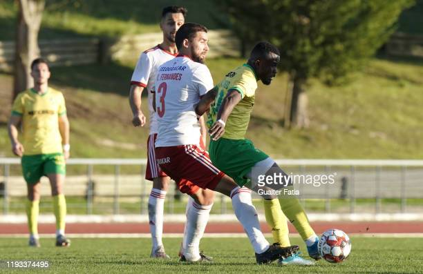 Paul Ayongo of CD Mafra with Kassio of UD Vilafranquense in action during the Liga Pro match between CD Mafra and UD Vilafranquense at Estadio do...