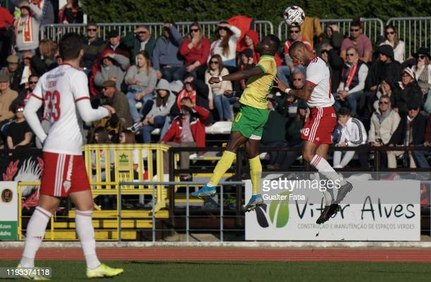 Paul Ayongo of CD Mafra with Ulisses Oliveira of UD Vilafranquense in action during the Liga Pro match between CD Mafra and UD Vilafranquense at...