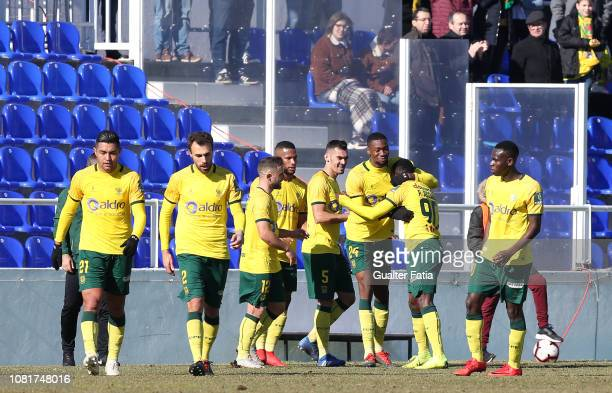 Paul Ayongo of FC Pacos de Ferreira celebrates with teammates after scoring a goal during the Liga Ledman Pro match between CD Cova da Piedade and FC...