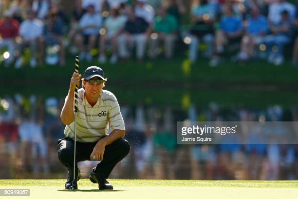 Paul Azinger lines up a putt on a green during the Par 3 Contest prior to the start of the 2008 Masters Tournament at Augusta National Golf Club on...