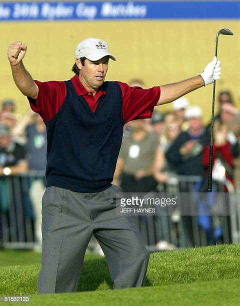 Paul Azinger of the US celebrates after making his sand shot on the 18th hole during the 34th Ryder Cup 29 September, 2002 on the Brabazon Course at...
