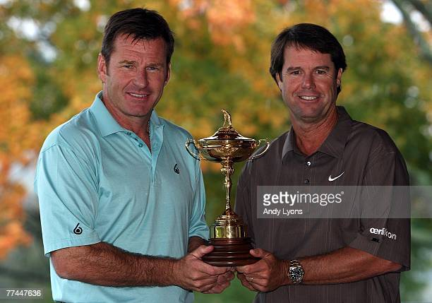 Paul Azinger the Captain of the USA Team and Nick Faldo the Captain of The European Team pose with the Ryder Cup trophy during the media event at...