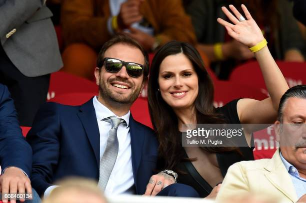 Paul Baccaglini, President of Palermo, and Thais Souza Wiggers wave during the Serie A match between AC Milan and US Citta di Palermo at Stadio...