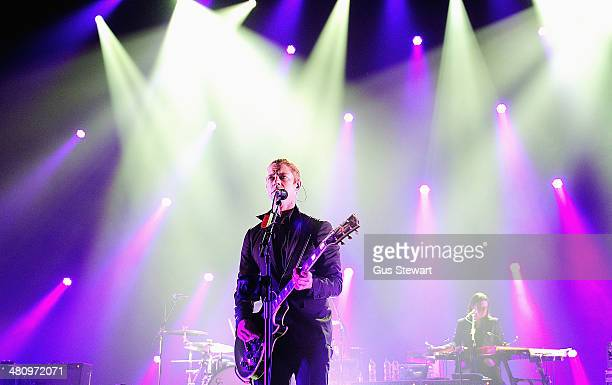 Paul Banks and Brandon Curtis of Interpol perform on stage for NME Awards Tour at Brixton Academy on March 27 2014 in London United Kingdom