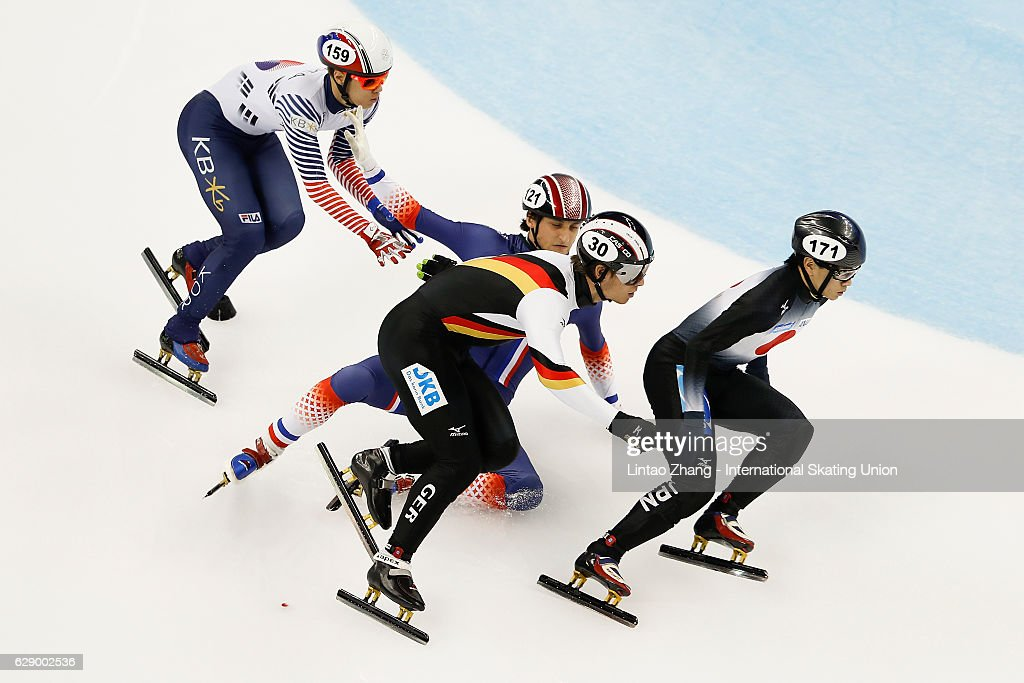 Paul Beauchamp of France fall after crash with Kei Saito of Japan, Da Woon Sin of Korea and Felix Spiegl of Germany competes in the men's 500m Quarterfinals on day two of the ISU World Cup Short Track speed skating event at the Oriental Sports Center on December 11, 2016 in Shanghai, China.