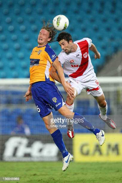 Paul Beekmans of United and Jason Hoffman of the Heart compete for the ball during the round 14 A-League match between Gold Coast United and the...