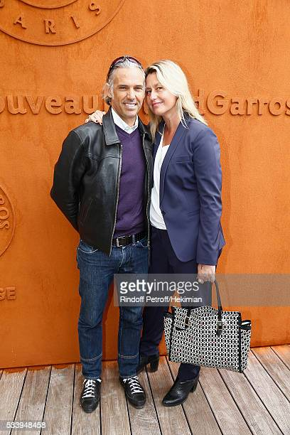 Paul Belmondo and his wife Luana attend the 2016 French Tennis Open Day Three at Roland Garros on May 24 2016 in Paris France