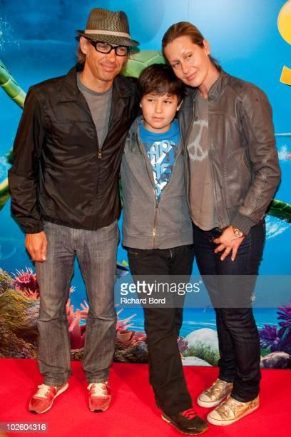Paul Belmondo his son Giacomo and his wife Luana attend Le Voyage Extraordinaire de Samy Paris Premiere at Cinema Gaumont Capucine on July 3 2010 in...