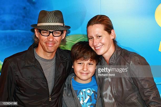 Paul Belmondo his son Giacomo and his wife Luana pose as they attend Le Voyage Extraordinaire de Samy Paris Premiere at Cinema Gaumont Capucine on...