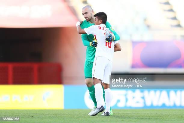 Paul Bernardoni of France and Thanh Binh Dinh of Vietnam hug after the FIFA U20 World Cup Korea Republic 2017 group E match between France and...