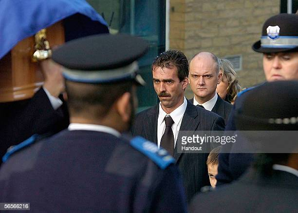 Paul Beshenivsky the husband of Police Constable Sharon Beshenivsky and his son Joshua arrive for her funeral of at Bradford Cathedral on January 11...