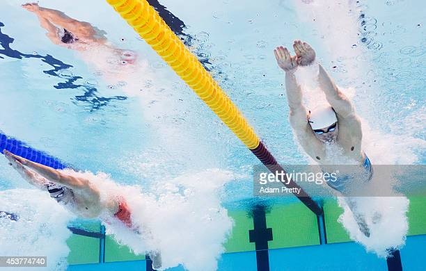 Paul Biedermann of Germany and Ferry Weertman of the Netherlands dives in for the start of the Men's 400m Freestyle heats at Europa-Sportpark on...