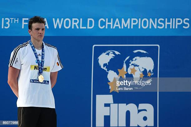 Paul Biedermann of Germany receives the gold medal during the medal ceremony for the Men's 200m Freestyle Final during the 13th FINA World...