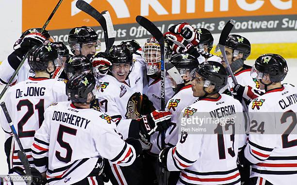 Paul Bittner and goaltender Adin Hill of the Portland Winterhawks celebrate their teams win over the Vancouver Giants after their WHL game at the...