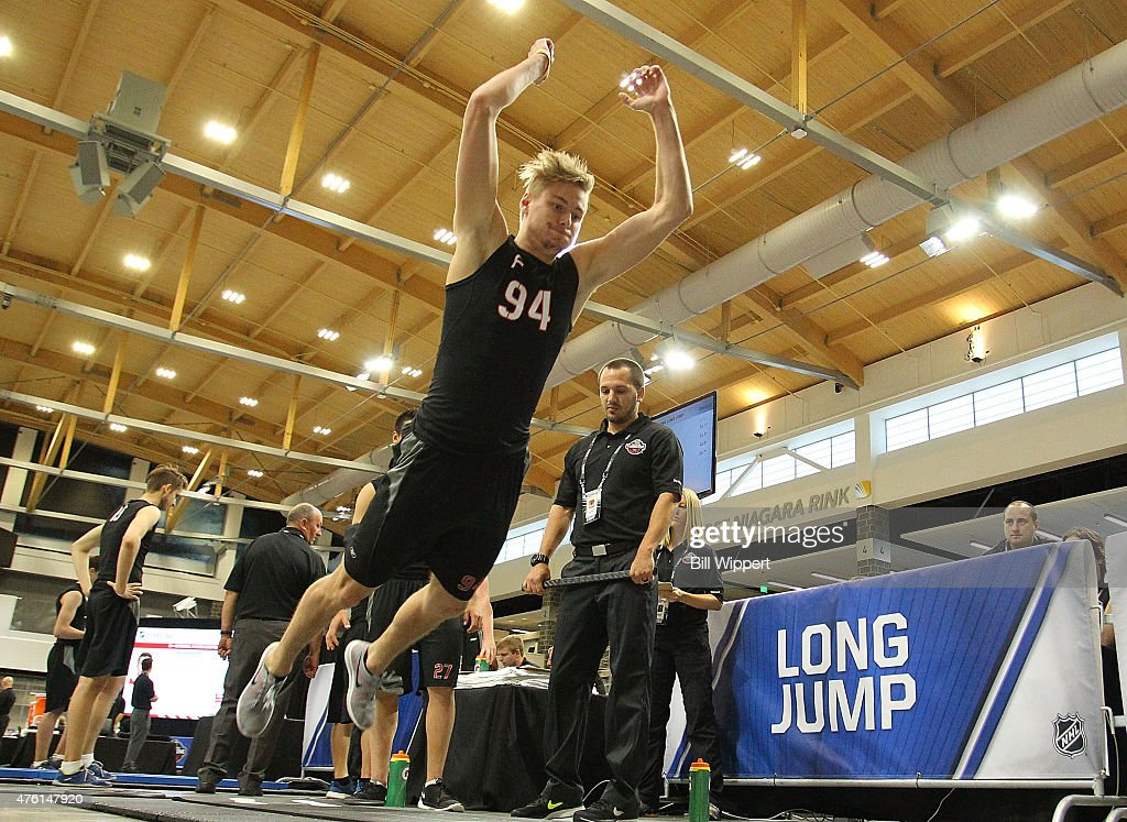 Paul Bittner does the long jump during the NHL Combine at HarborCenter on June 6, 2015 in Buffalo, New York.