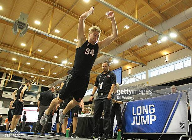 Paul Bittner does the long jump during the NHL Combine at HarborCenter on June 6 2015 in Buffalo New York