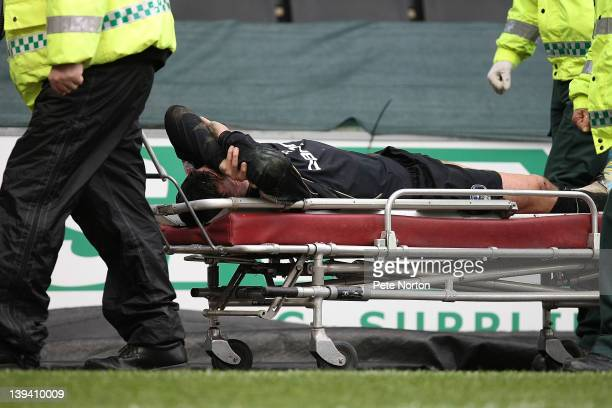 Paul Black of Oldham Athletic is taken from the pitch on a stretcher because of an injury during the npower League One match between MK Dons and...